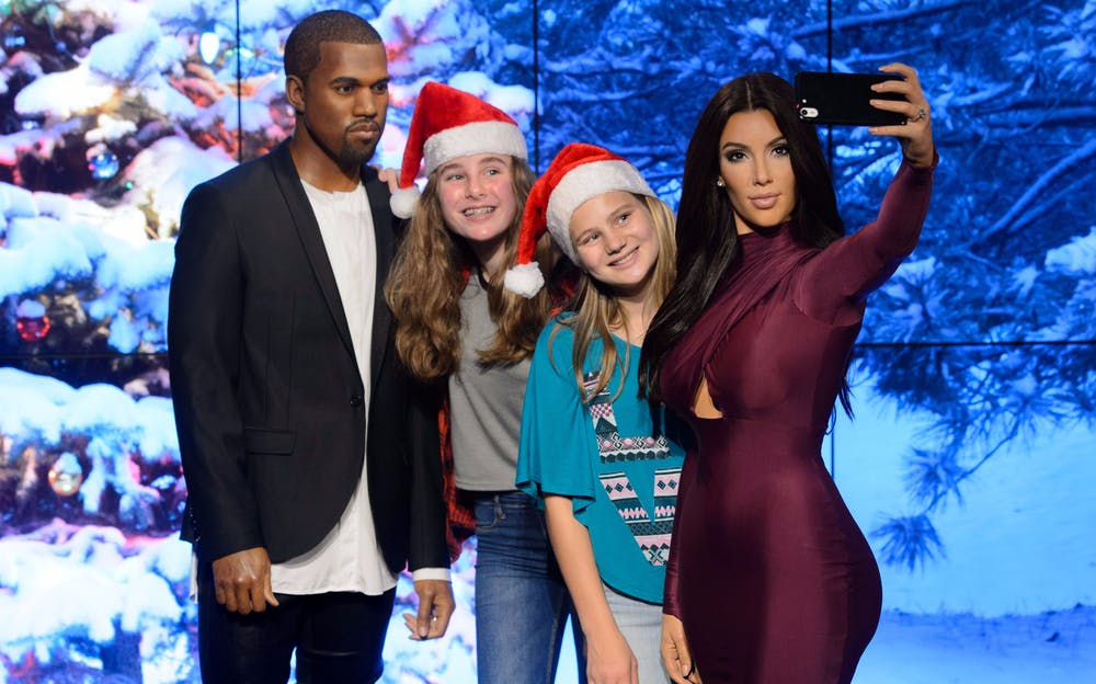 Madame Tussauds tickets - visitors pose with Kanye West and Kim Kardashian