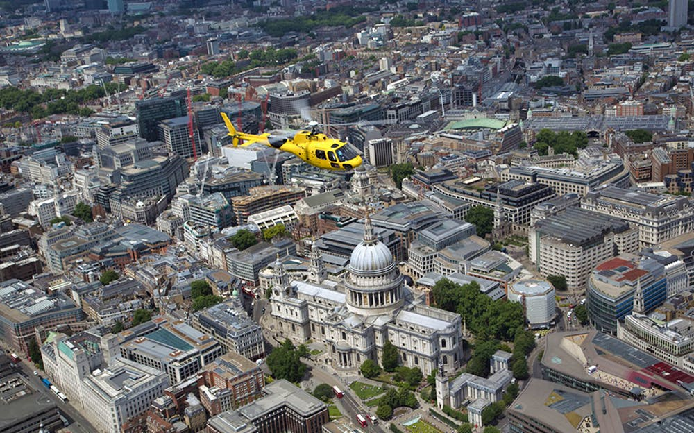 London helicopter ride - A helicopter high above London