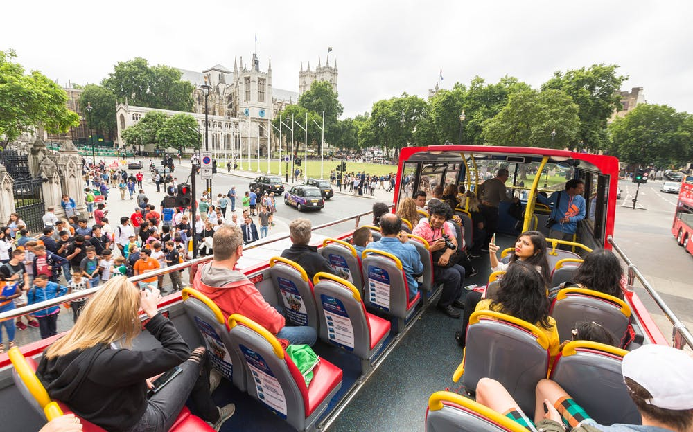 London Hop On Hop Off Bus Tour - Passengers aboard one of the open-top tour buses