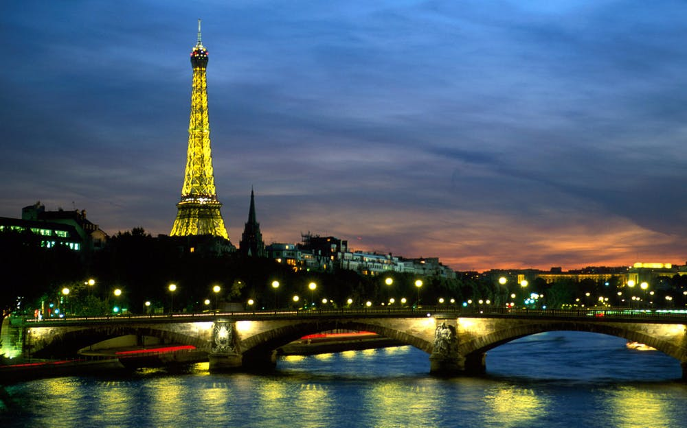 Seine Dinner Cruise - See the Eiffel Tower at night on a Seine Dinner Cruise