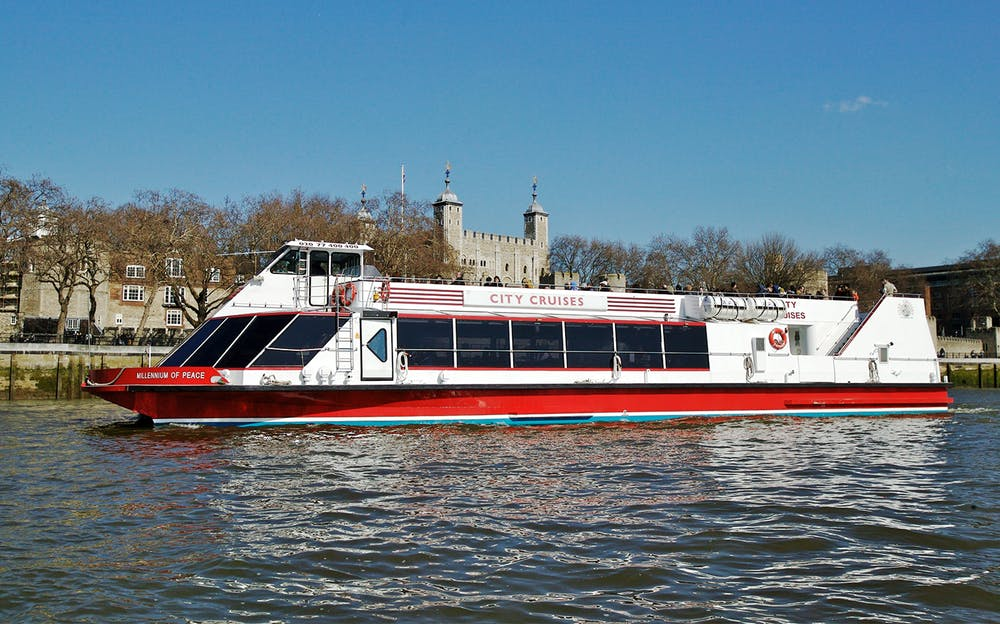 Madame Tussauds and River Cruise - A river boat on the Thames beside the Tower of London