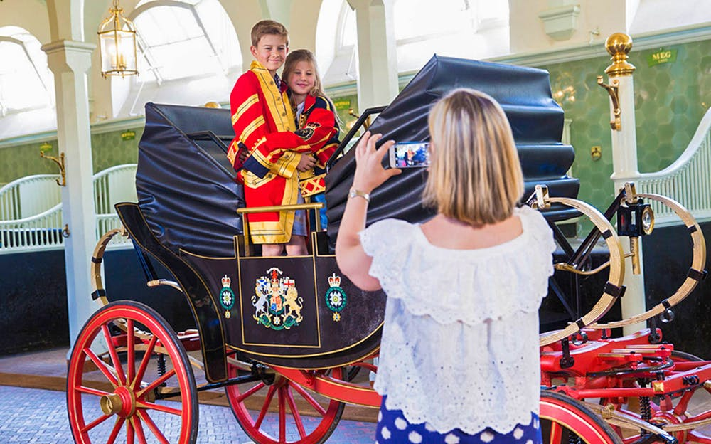 Royal Mews Tickets - Children aboard a carriage at Buckingham Palace